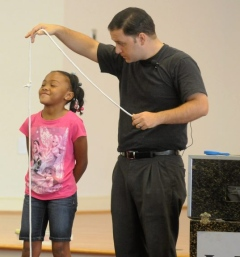 Magician Wes Iseli performs a show for the Petersburg Public Library's summer reading program Wednesday at the Tabernacle Baptist Church Community Life Center.